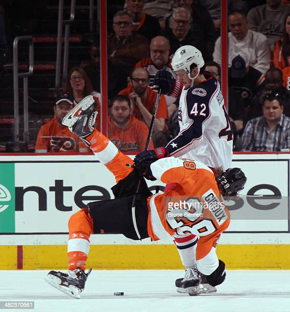 Artem Anisimov of the Columbus Blue Jackets flips Claude Giroux of the Philadelphia Flyers off the first period faceoff at the Wells Fargo Center on...