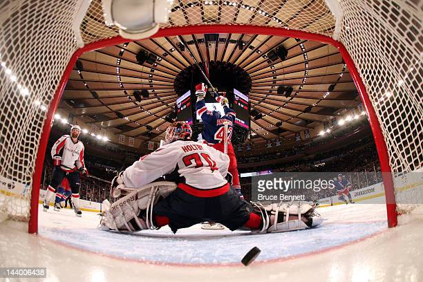 Artem Anisimov of the New York Rangers celebrates as teammate Marc Staal scores the winning goal in overtime against Braden Holtby of the Washington...