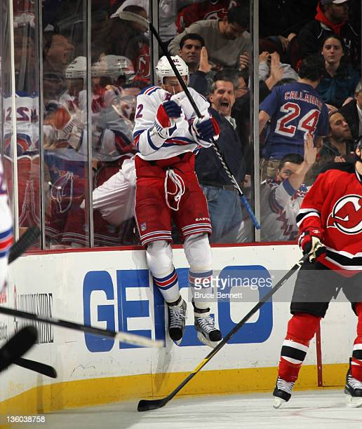 Artem Anisimov of the New York Rangers celebrates his goal at 17:28 of the second period against the New Jersey Devils by jumping into the glass at...