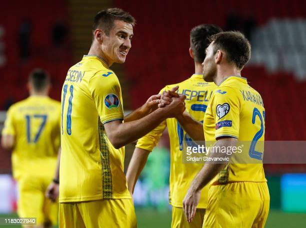 Artem Besedin of Ukraine celebrates after scoring a goal with Oleksandr Karavaev during the UEFA Euro 2020 Qualifier between Serbia and Ukraine on...