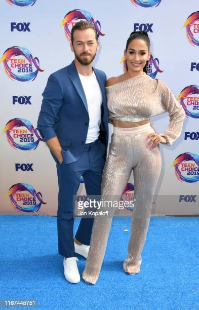 Artem Chigvintsev and Nikki Bella attend FOX's Teen Choice Awards 2019 on August 11 2019 in Hermosa Beach California
