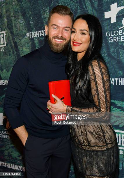 Artem Chigvintsev and Nikki Bella attend the PUBG Mobile's #FIGHT4THEAMAZON Event at Avalon Hollywood on December 09, 2019 in Los Angeles, California.