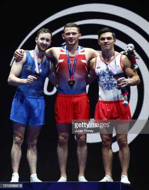 Artem Dolgopyat of Israel Dominick Cunningham of Great Britain and Artur Dalaloyan of Russia pose for a photo with their medals after the Floor...
