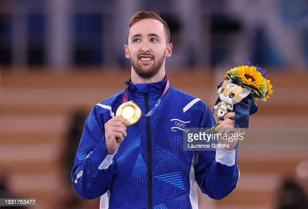 Artem Dolgopyat of Team Israel poses with the gold medal on the podium during the Men's Floor Exercise Victory Ceremony on day nine of the Tokyo 2020...