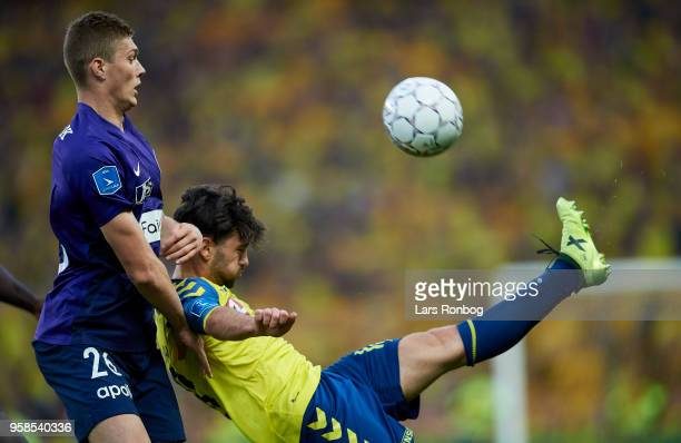 Artem Dovbyk of FC Midtjylland and Besar Halimi of Brondby IF compete for the ball during the Danish Alka Superliga match between Brondby IF and FC...