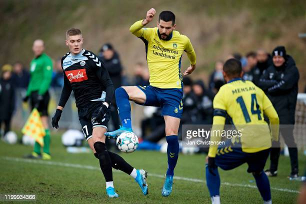 Artem Dovbyk of SonderjyskE and Anthony Jung of Brondby IF compete for the ball during the testmatch between Brondby IF and SonderjyskE at Brondby...