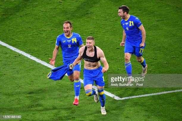 Artem Dovbyk of Ukraine celebrates with Yevhen Makarenko after scoring their side's second goal during the UEFA Euro 2020 Championship Round of 16...