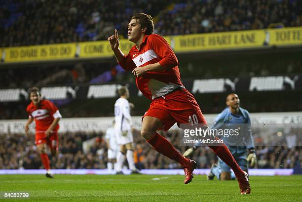 Artem Dzuba of Spartak celebrates after rounding Heurelho Gomes of Spurs to score his team's second goal during the UEFA Cup Group D match between...