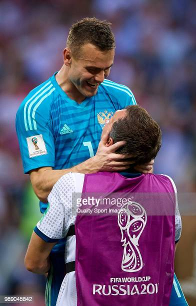 Artem Dzyuba and Igor Akinfeev of Russia celebrates the victory at the end of the 2018 FIFA World Cup Russia Round of 16 match between Spain and...