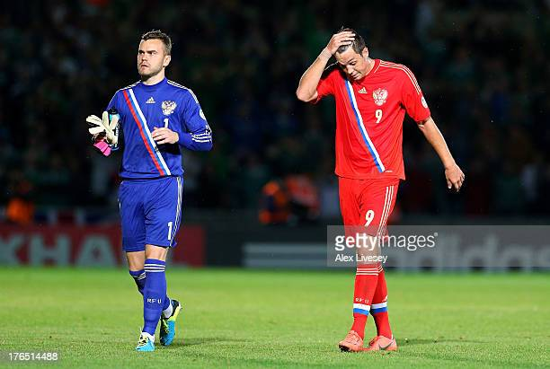 Artem Dzyuba and Igor Akinfeev of Russia look dejected after defeat to Northern Ireland in the FIFA 2014 World Cup Group F Qualifier match between...