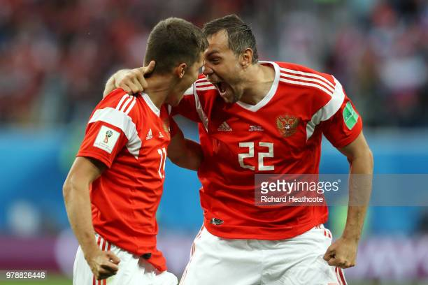 Artem Dzyuba and Roman Zobnin of Russia celebrate the first Russia goal an own goal by Ahmed Fathi of Egypt during the 2018 FIFA World Cup Russia...