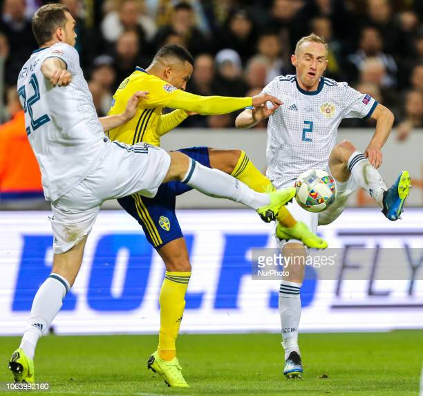Artem Dzyuba and Vladislav Ignatyev of the Russia vie for the ball during the UEFA Nations League B group two match between Sweden and Russia at...
