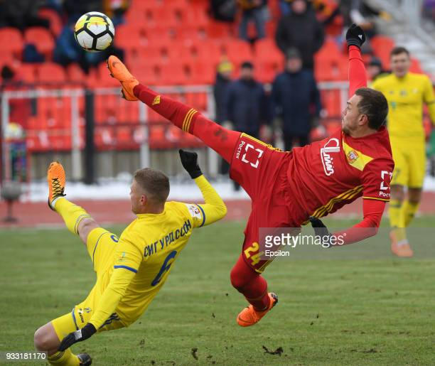 Artem Dzyuba of FC Arsenal Tula vies for the ball with Ragnar Sigurdsson of FC Rostov during the Russian Premier League match between FC Arsenal Tula...