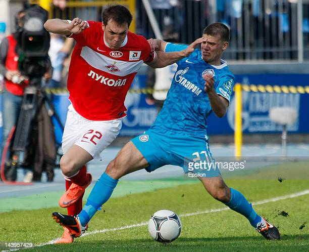 Artem Dzyuba of FC Spartak Moscow and Igor Denisov of FC Zenit St Petersburg vie for the ball during the Russian Football League Championship match...
