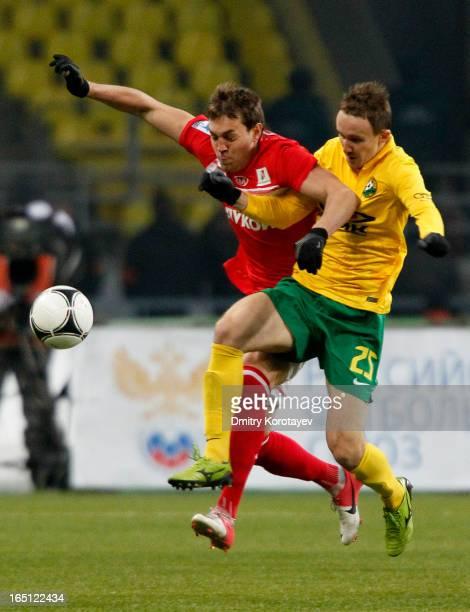 Artem Dzyuba of FC Spartak Moscow battles for the ball with Aleksei Kozlov of FC Kuban Krasnodar during the Russian Premier League match between FC...