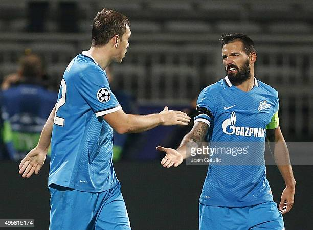 Artem Dzyuba of FC Zenit celebrates scoring his second goal with Danny during the UEFA Champions league match between Olympique Lyonnais and FC Zenit...