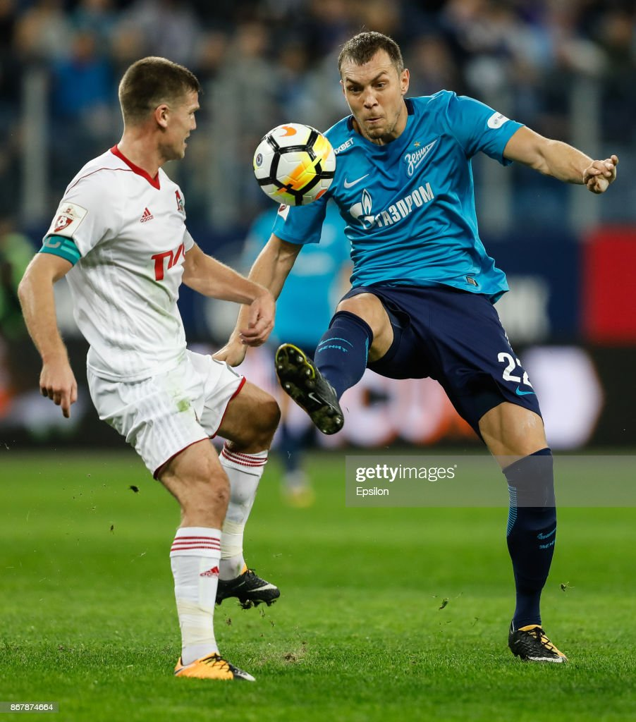 Artem Dzyuba (R) of FC Zenit Saint Petersburg and Igor Denisov of FC Lokomotiv Moscow vie for the ball during the Russian Football League match between FC Zenit St. Petersburg and FC Lokomotiv Moscow on October 29, 2017 at Saint Petersburg Stadium in Saint Petersburg, Russia.