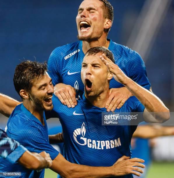 Artem Dzyuba of FC Zenit Saint Petersburg celebrates his goal with Anton Zabolotny and Aleksandr Erokhin of FC Zenit Saint Petersburg during the UEFA...