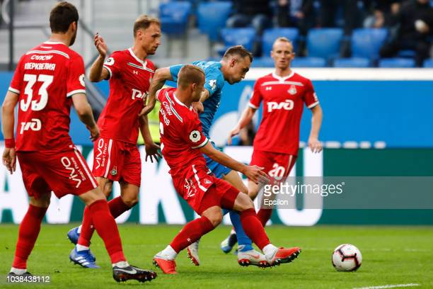 Artem Dzyuba of FC Zenit Saint Petersburg vies for the ball with Solomon Kvirkvelia , Benedikt Howedes , Dmitri Barinov and Vladislav Ignatyev of FC...