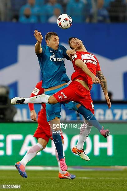 Artem Dzyuba of FC Zenit St Petersburg and Salvatore Bocchetti of FC Spartak Moscow vie for a header during the Russian Football League match between...