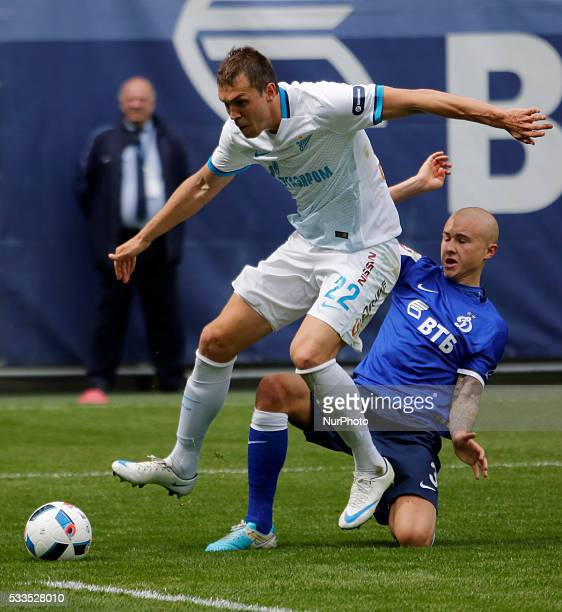 Artem Dzyuba of FC Zenit St Petersburg and Sebastian Holmen of FC Dynamo Moscow vie for the ball during the Russian Football Premier League match...
