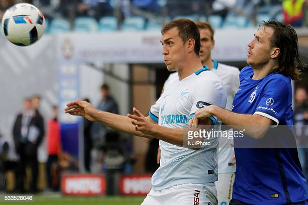 Artem Dzyuba of FC Zenit St Petersburg and Vitali Dyakov of FC Dynamo Moscow vie for the ball during the Russian Football Premier League match...