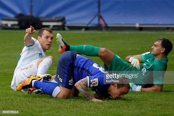 Artem Dzyuba of FC Zenit St Petersburg Andrey Yeshchenko of FC Dynamo Moscow and Vladimir Gabulov of FC Dynamo Moscow react on a scored goal during...