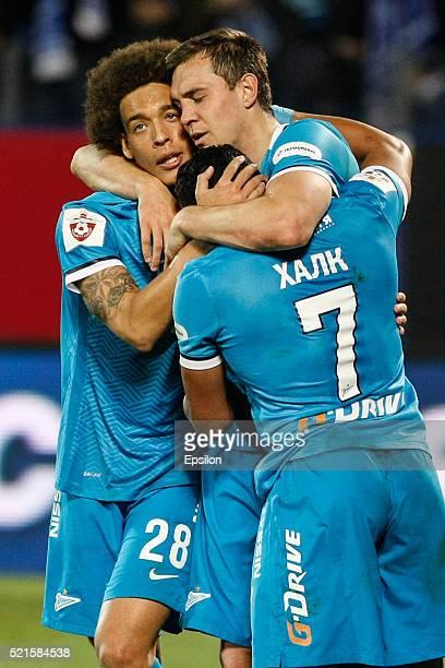 Artem Dzyuba of FC Zenit St Petersburg celebrates his goal with Axel Witsel of FC Zenit St Petersburg and Hulk of FC Zenit St Petersburg during the...