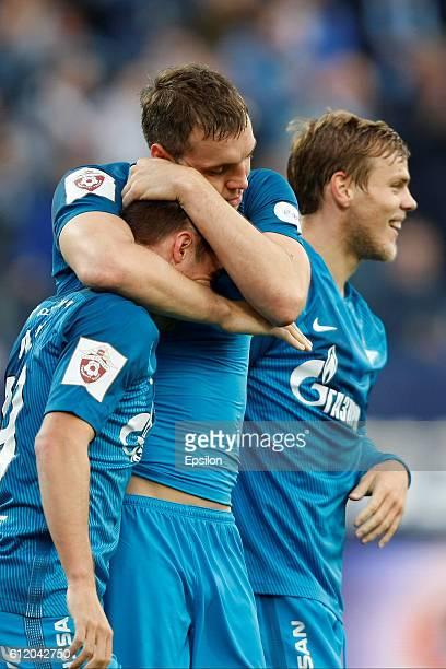 Artem Dzyuba of FC Zenit St Petersburg celebrates his goal with Robert Mak and Aleksandr Kokorin of FC Zenit St Petersburg during the Russian...