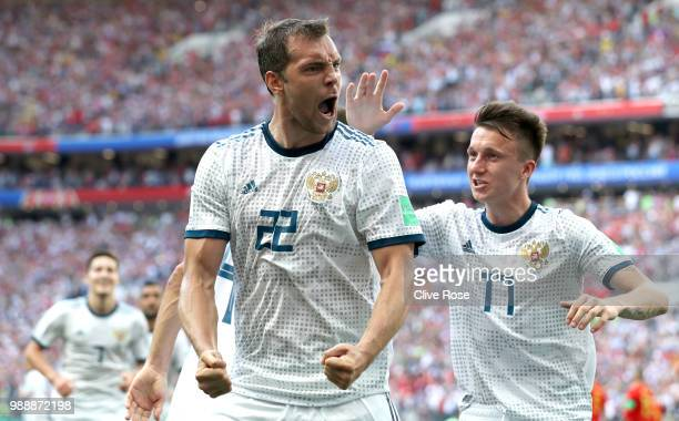 Artem Dzyuba of Russia celebrates after scoring his team's first goal during the 2018 FIFA World Cup Russia Round of 16 match between Spain and...