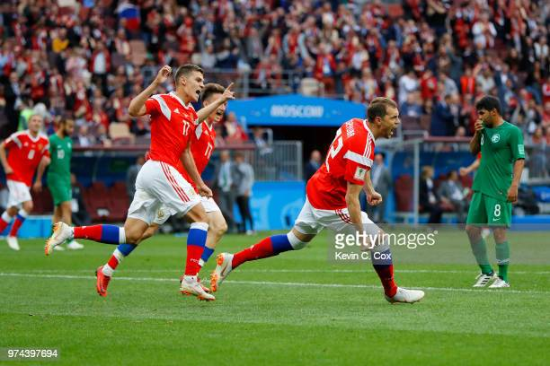 Artem Dzyuba of Russia celebrates after scoring his team's third goal during the 2018 FIFA World Cup Russia Group A match between Russia and Saudi...