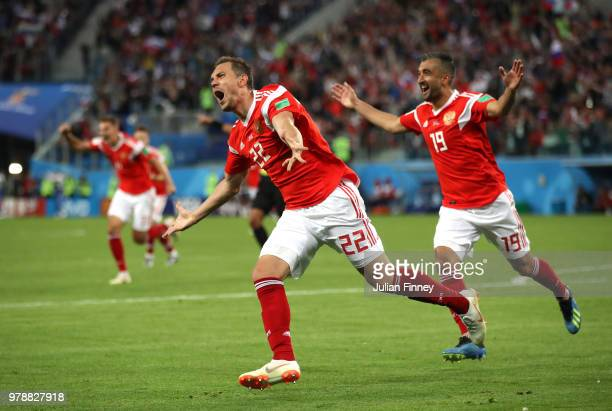 Artem Dzyuba of Russia celebrates after scoring his team's third goal during the 2018 FIFA World Cup Russia group A match between Russia and Egypt at...