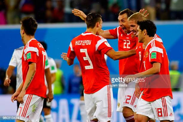 Artem Dzyuba of Russia celebrates after scoring the third goal of his team during the 2018 FIFA World Cup Russia group A match between Russia and...