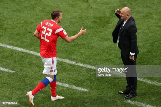 Artem Dzyuba of Russia celebrates with Stanislav Cherchesov, Head Coach of Russia after scoring his team's third goal during the 2018 FIFA World Cup...
