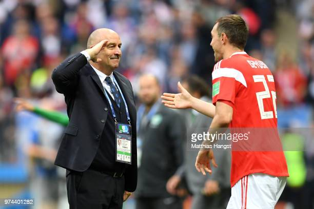 Artem Dzyuba of Russia celebrates with Stanislav Cherchesov Head Coach of Russia after scoring his team's third goal during the 2018 FIFA World Cup...