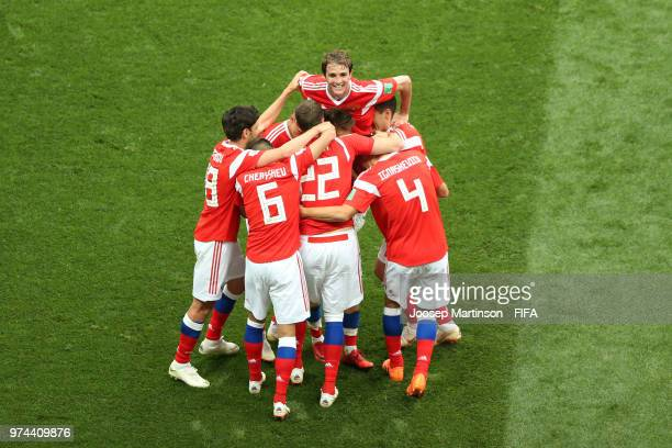 Artem Dzyuba of Russia celebrates with teammates after scoring his team's third goal during the 2018 FIFA World Cup Russia group A match between...