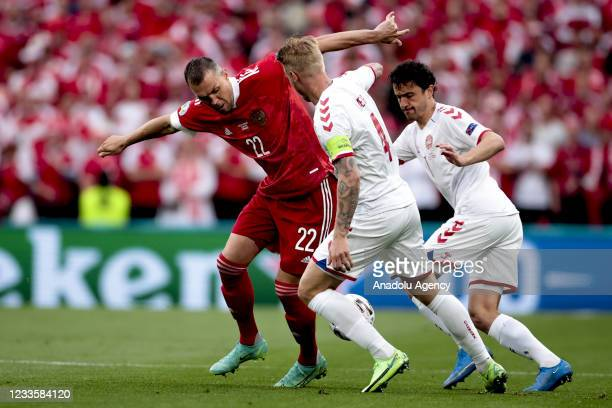 Artem Dzyuba of Russia in action against Simon Kjaer of Denmark during the EURO 2020 Group B third match between Russia and Denmark at Parken Stadium...