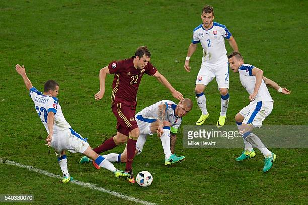 Artem Dzyuba of Russia is surrounded by Slovakian players during the UEFA EURO 2016 Group B match between Russia and Slovakia at Stade Pierre-Mauroy...