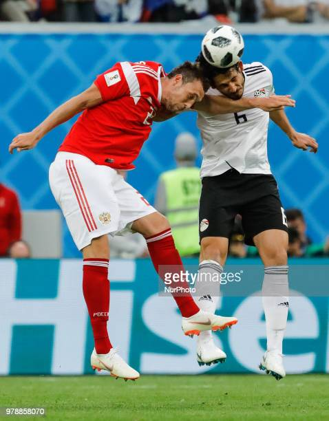 Artem Dzyuba of Russia national team and Ahmed Hegazy of Egypt national team vie for a header during the 2018 FIFA World Cup Russia group A match...