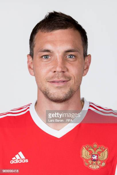 Artem Dzyuba of Russia poses for a portrait during the official FIFA World Cup 2018 portrait session at Federal Sports Centre Novogorsk on June 8...