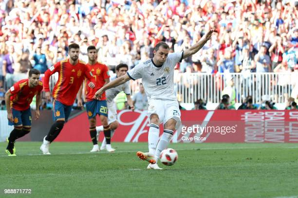Artem Dzyuba of Russia scores a penalty for his team's first goal during the 2018 FIFA World Cup Russia Round of 16 match between Spain and Russia at...