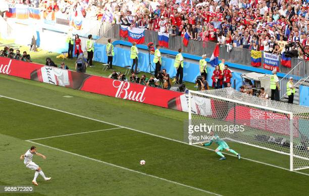 Artem Dzyuba of Russia scores a penalty past David De Gea of Spain for his team's first goal during the 2018 FIFA World Cup Russia Round of 16 match...