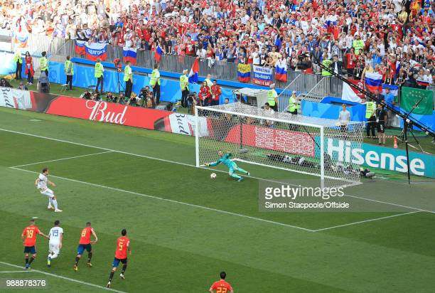 Artem Dzyuba of Russia scores their 1st goal from the penalty spot during the 2018 FIFA World Cup Russia Round of 16 match between Spain and Russia...
