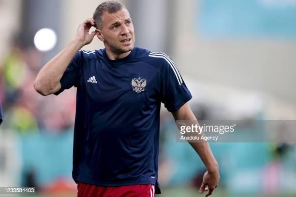 Artem Dzyuba of Russia warms up ahead of EURO 2020 Group B third match between Russia and Denmark at Parken Stadium in Copenhagen, Denmark on June...