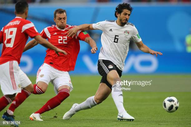 Artem Dzyuba of the Russia national football team and Ahmed Hegazy of the Egypt national football team vie for the ball during the 2018 FIFA World...