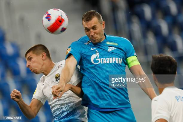Artem Dzyuba of Zenit and Igor Yurganov of Sochi vie for a header during the Russian Premier League match between FC Zenit Saint Petersburg and FC...