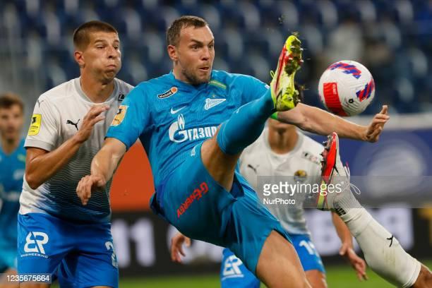 Artem Dzyuba of Zenit and Igor Yurganov of Sochi vie for the ball during the Russian Premier League match between FC Zenit Saint Petersburg and FC...