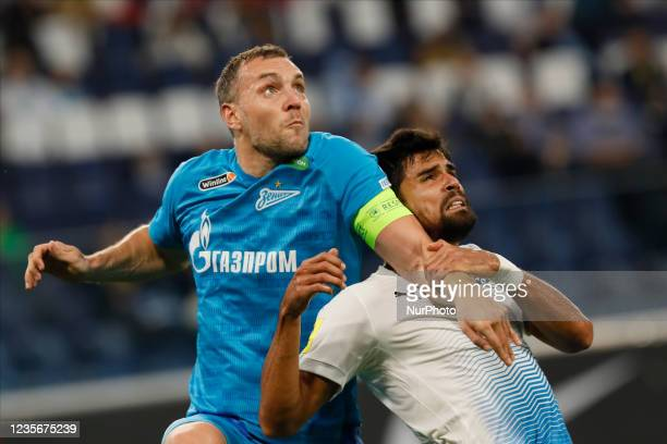 Artem Dzyuba of Zenit and Rodrigao of Sochi in action during the Russian Premier League match between FC Zenit Saint Petersburg and FC Sochi on...