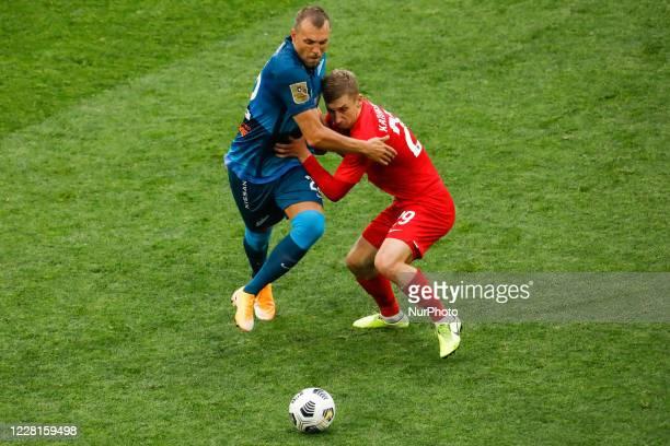 Artem Dzyuba of Zenit Saint Petersburg and Oleksandr Kapliyenko of Tambov vie for the ball during the Russian Premier League match between FC Zenit...