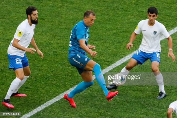 Artem Dzyuba of Zenit Saint Petersburg in action against Miha Mevlja and Ibragim Tsallagov of PFC Sochi during the Russian Premier League match...